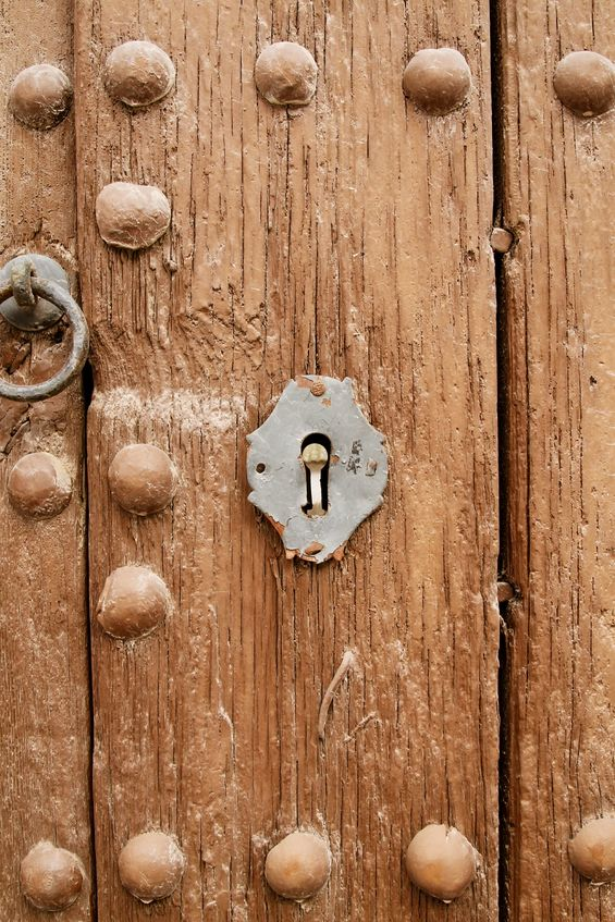 Old wooden door with keyhole. Andalusia Spain